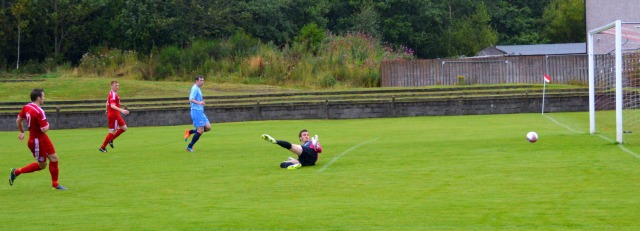 Mick McCann slots home the equaliser