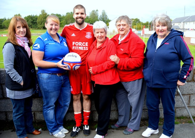 Glenafton Athletic Ladies Committee, sponsors of the match ball, with club captain Craig Menziess