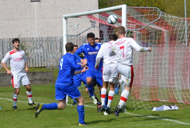 Cammy Marlow and Darren McGill head for goal