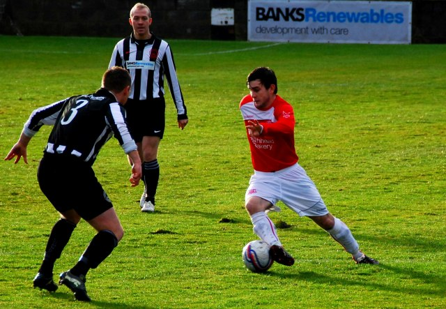 Paul McKenzie skips past Stuart McDonald