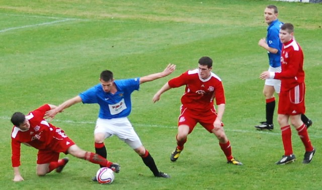 Paul McKenzie nicks the ball from Richie Barr