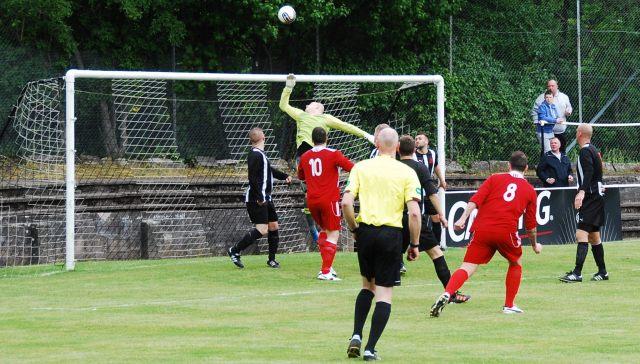 Ross Robertson heads for goal