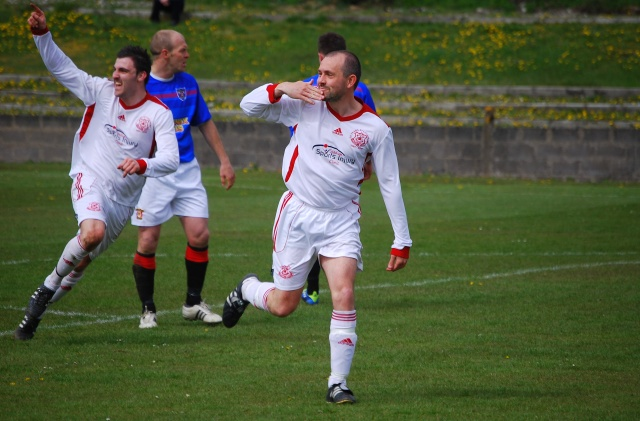 Potts celebrates a goal against the Medda