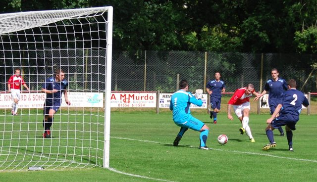 Ross Robertson picks his spot for the opening goal