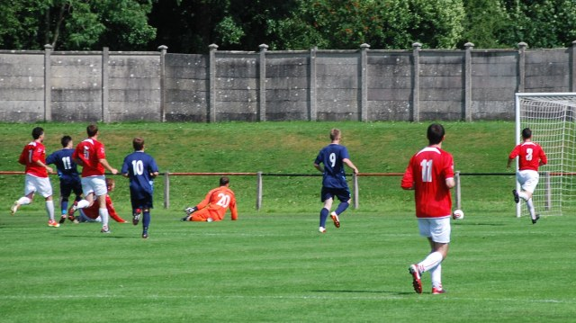 Lewis Sloan (11) slots home the equaliser