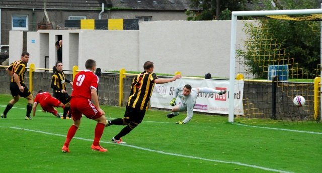 Cammy Marlow's shot saved by Andy Leishman