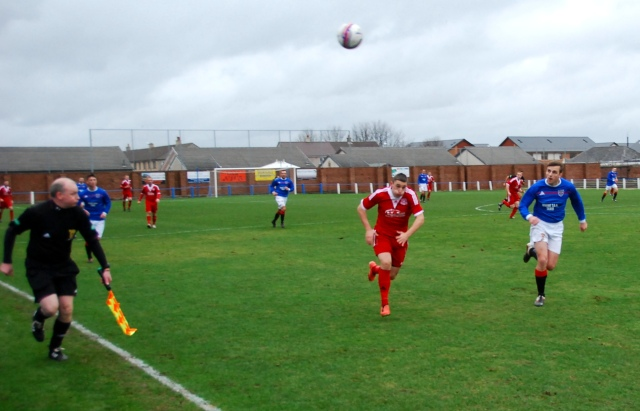 Aaron Connoly hunts down the ball