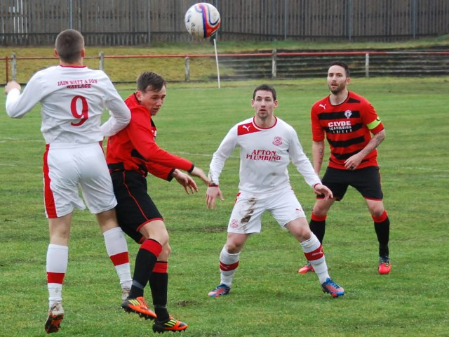 Aaron Connolly and Alain Kinney challenge as Gordon Moffat looks on