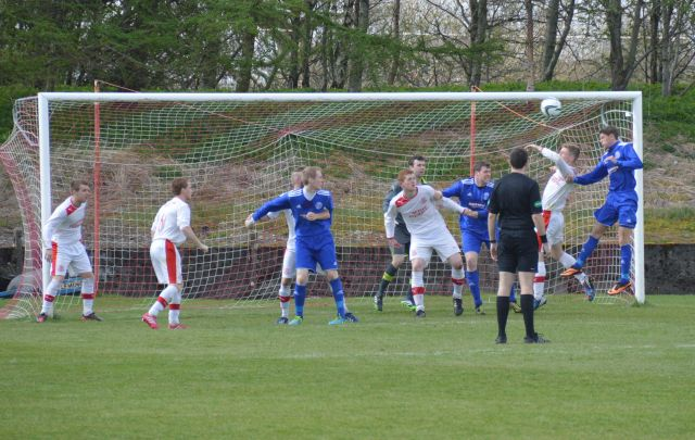 Darren McGill beats Liam Finnigan to the header