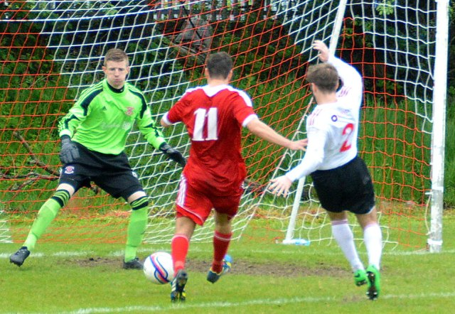 Cammy clips home the Glens third goal