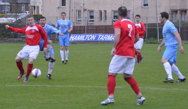 Darren McGill beats Paal McKenzie to the ball