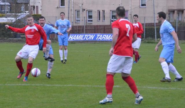 Darren McGill beats Paal McKenzie to the ball