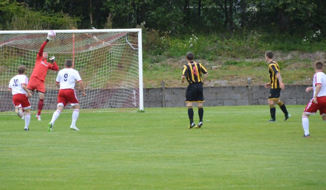 Andy Leishman saves from Jamie McKernon