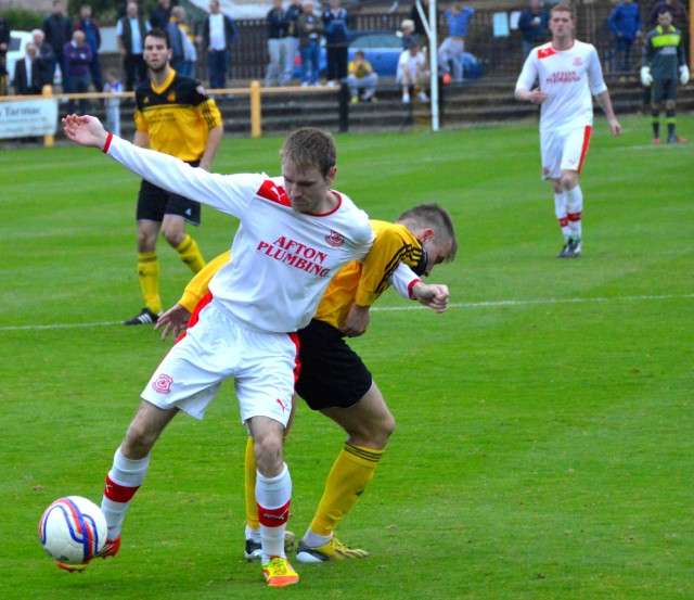 Adam Strachan on the ball
