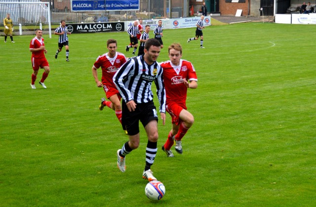 Andy Reid leads the charge for the opening goal