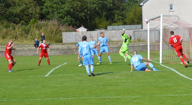 Chris Meikle's shot crashes off the bar