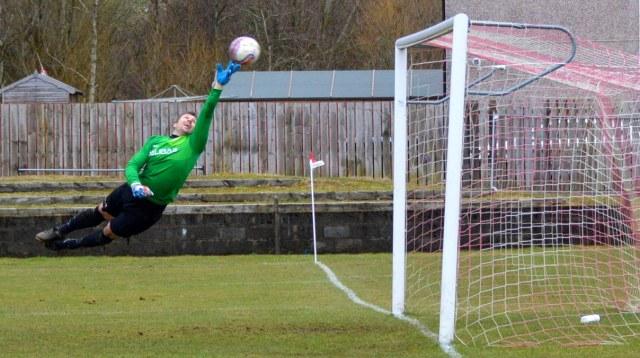 Aaron's free kick sails into the net