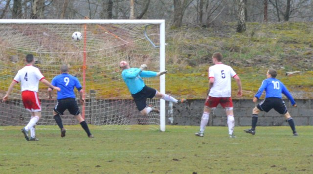 Dale Moore (out of picture) fires home