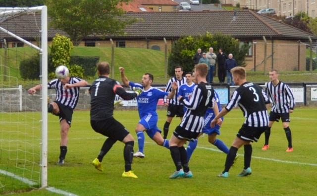 James Lundie hooks clear as Joe Andrew looks to strike