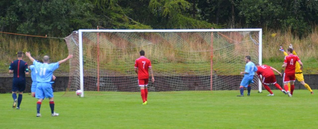 Ross Robertson (obscured) scores at the back post