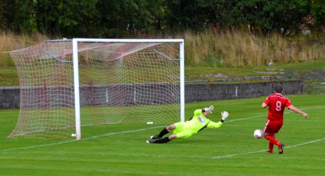 Alan Colquhouns saves from Mick McCann